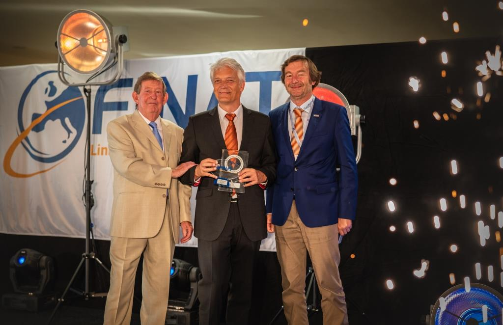 Carini receives Group E award